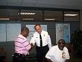 Radio Host Pierre Nazon Beauliere shaking hands with Fire Chief Herminio Lorenzo/ Miami-Dade Fire Rescue
