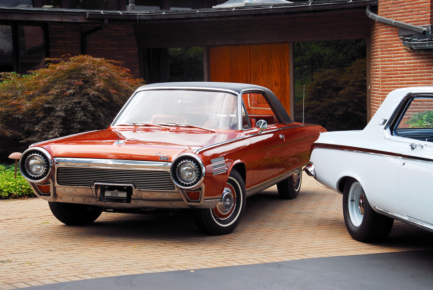 10 1963 Chrysler Ghia Turbine Car with 1963 Dodge Polara front view at sixties-era modern home