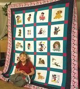Jenna F. with her quilt