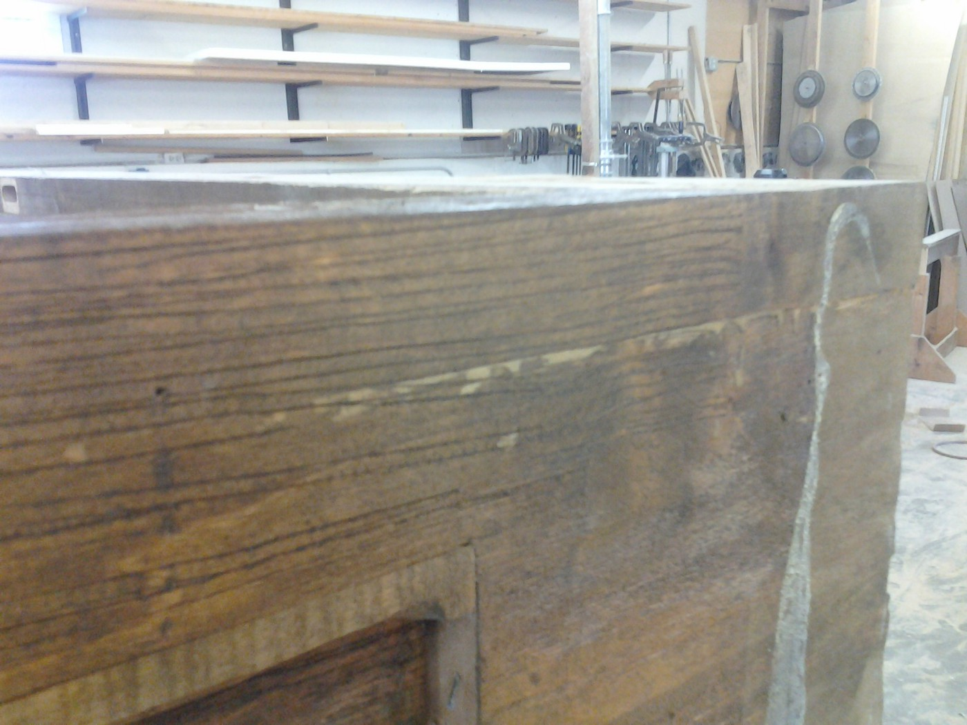 Lots of glue all over the cabinet that was never sanded before stain and finish.