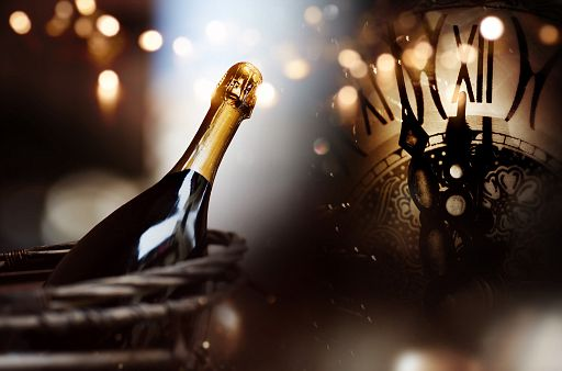 Congratulations with a bottle champagne and clock for new year