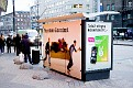 Tele2 have set a sofa at a bus stop as a part of a new advertising campaign. (back view)