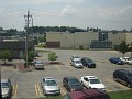 Looking out the window at my brother's old job site, looking at the back of Hannaford's on Route 9. The blue Cobalt at the far right is his car.