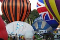 Balloonists Tussling To Inflate Canopies